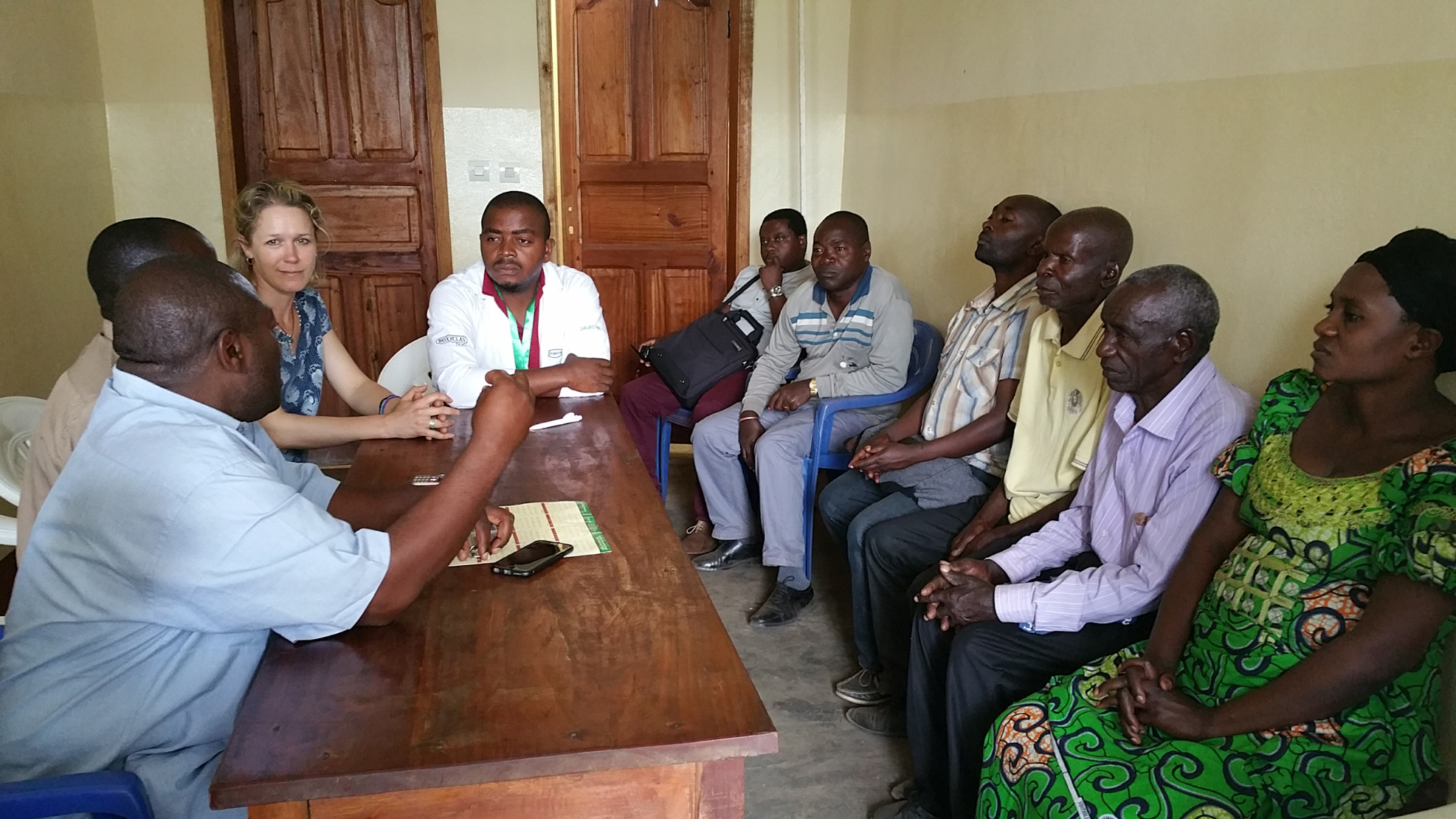 Bulenga Clinic staff meet with Beth Ann and representatives of SOPACDI to talk about the clinic and needs of the community