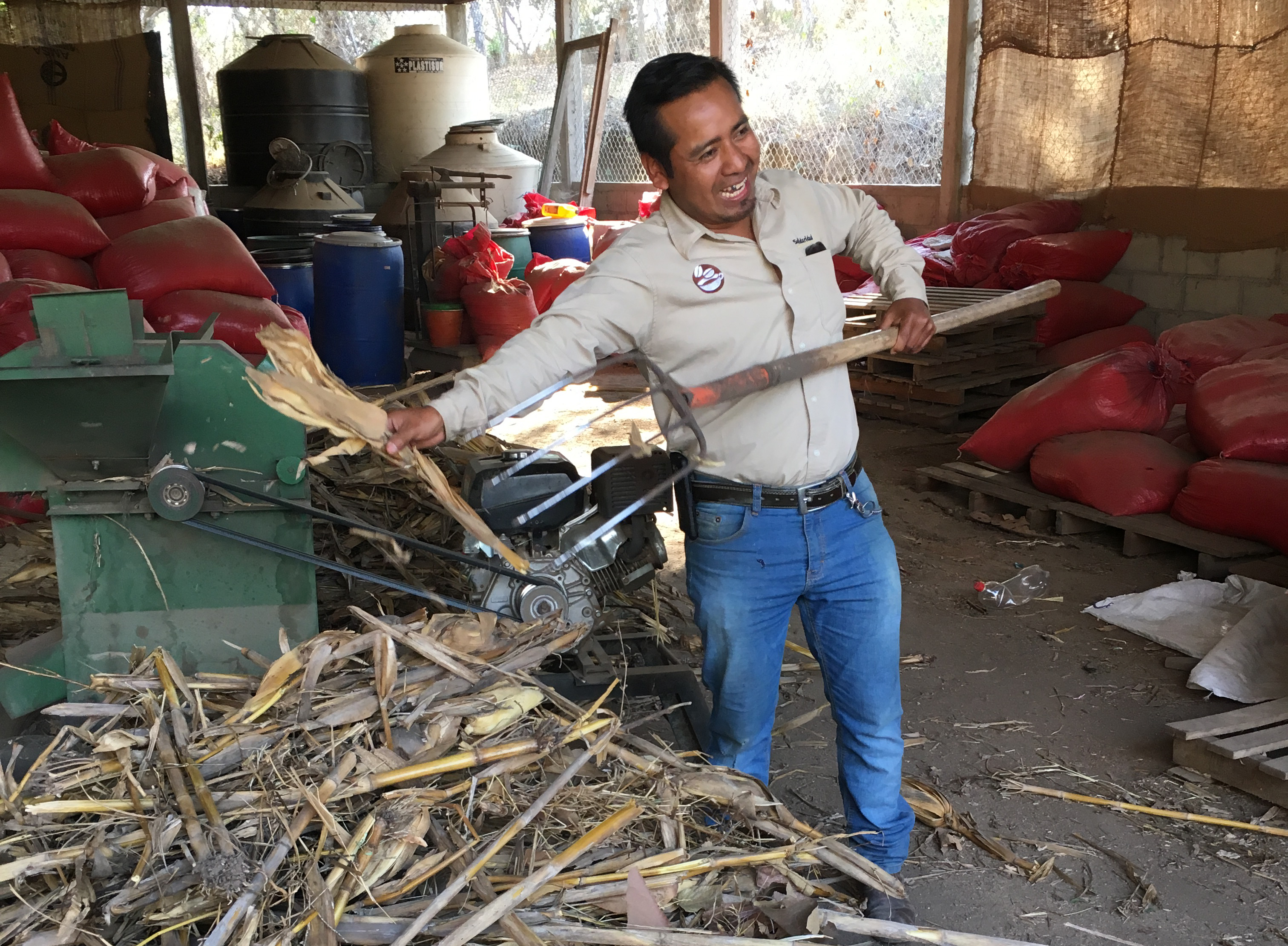 Alonso Gomez Hernandez, a member of the CYN staff shows off some of the raw material that gets transformed into organic fertilizer