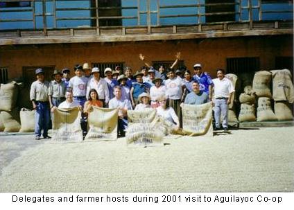 Delegates and farmer hosts during 2001 visit