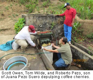 Scott Owen, Tom Wilde, and Roberto Pezo depulping coffee cherries