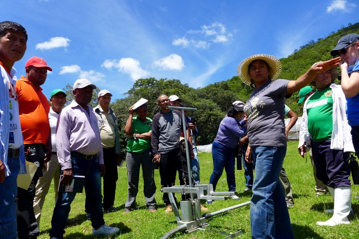 Joselinda Manueles of COMSA Co-operative in Honduras explains her irrigation system to participants in one of the grant's productivity exchanges