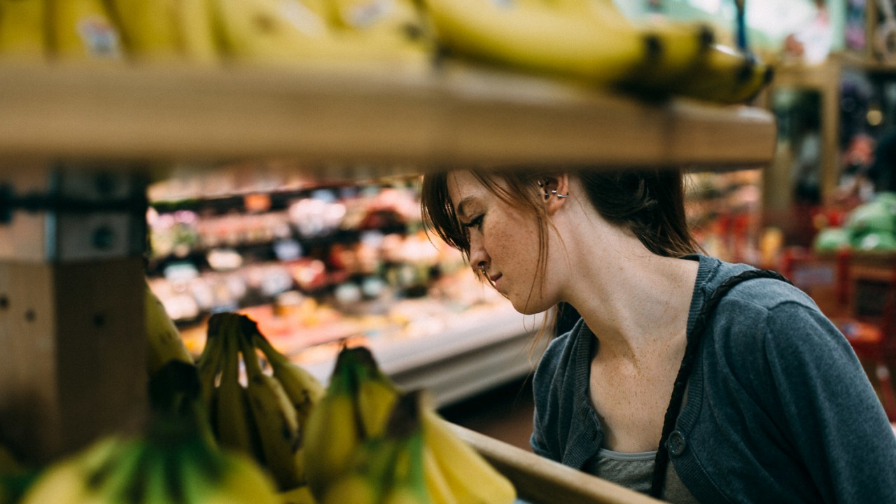 a shopper buys bananas