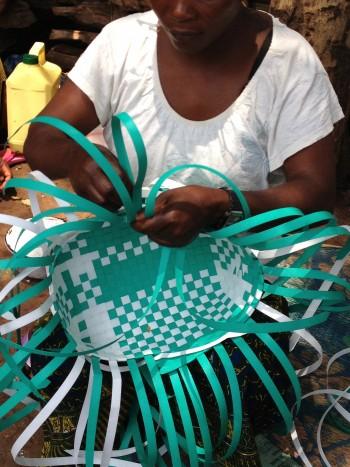 Woman weaving a Panzi Bag